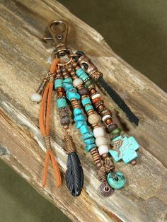 StoneWearDesigns Handcrafted Beaded Jewelry for Women and Men Purse Charm - Zipper Pull - Keychain Charm - Charm Tassel - Southwest Charms - Belt Loop Clip - Native Tribal Charms I loove this..its sooo beautiful!! I love a light leather with turquoise..it looks great!!