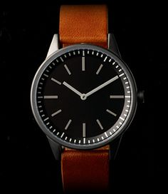 Primary photograph of product 251 Series (PVD Gun Grey / Tan Leather)