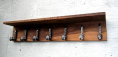 Home Decor Wall Coat Rack With Railroad Spike Hooks. Beautiful wall coat rack, another hand made well designed product from us. Unique and strong, which will last for a very long time. Can be used for coats, towels. The top shelf is useful for keys, gloves, hats or you can make your own decor with flowers... Size: 36 x 7 Custom orders are welcome if you are looking for a different size to fit your needs! Please contact me with your request and I will get back to you with a quote. Wall…