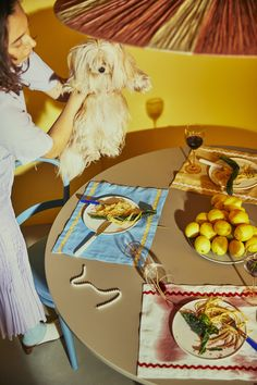 Dinnerparty - wine and pasta - pretty mess - small dog.