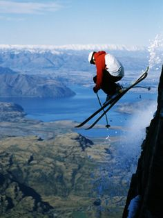 Skier Dropping off Cliff at Treble Cone Ski Resort, Wanaka, New Zealand - should this be On Snow and Ice or maybe Airborn!
