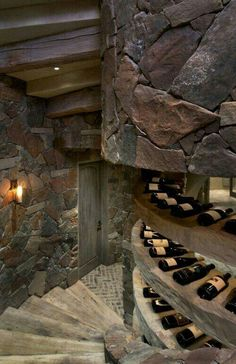 Wine cellar - love the circular stone steps to the basement.  <3