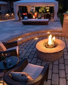 Rattan garden furniture with stone firepit. Modern backyards with outdoor fire place, Rattan furniture and Pergola