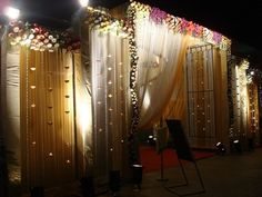 white and pink entrance , subtle and classy entrance , drapes and flowers entrance , engagement function decor