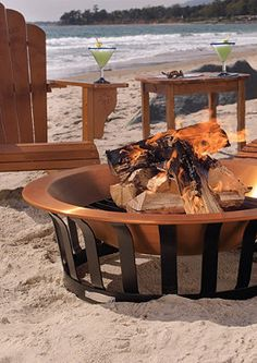 A beach fire pit is the perfect way to sit back and relax on the beach with a cocktail.