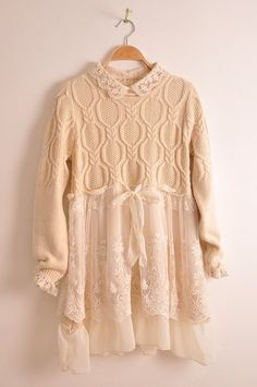 interesting combination of gauzy lace fabric and hand knit