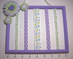 Hair bow and headband holder, picture frame hair accessories organizer, girls room decor, purple and lime green. $30.00, via Etsy.