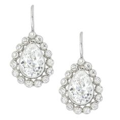 A pair of pear shape diamond cluster drop earrings
