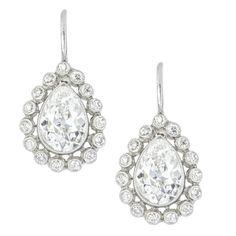 A pair of pear shape diamond cluster drop earrings