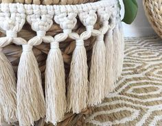 """Large Macrame Tassel Wrap made of 100% Natural Cotton Cord. Bring some texture and Bohemian feels into your home. Tie around your pot plants, use as bunting or wall hanging, sooo many uses. Everyone LOVES tassles!!!!▴ A P P R O X D I M E N S I O N S▴ Macrame Width - 25""""▴ Macrame Height - 7""""▴ Tie Length - 45""""Easily ad"""