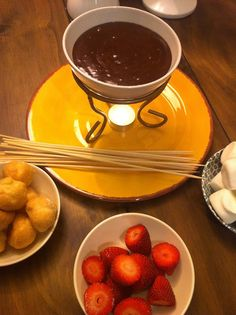 DIY Fondue Pot For Two! Using clearance and thrift store items, create your own fondue set for a romantic Valentine's Day dessert! Easy chocolate fondue recipe included!