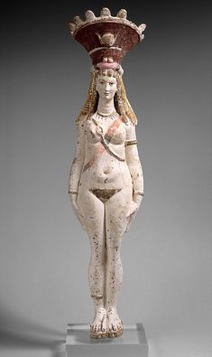 Ancient Egyptian Greco-Roman figure of Isis-Aphrodite; her calathos/crown has the winged sun disc and horns of Isis.