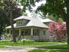 Love the metal roof on the craftsman-style bungalow