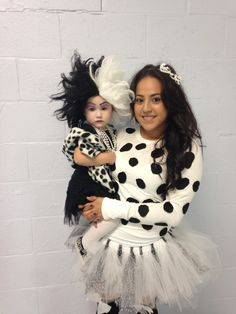 Matching Halloween costumes for daughter and mother. Cruella Deville and a Dalmatian :) NAILED IT!!! Parenting, you're doing it right!