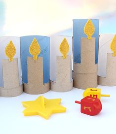 Cardboard Tube Menorah This Hanukkah have the kids put together this cool menorah using recycled cardboard tubes and craft foam. Its a great holiday activity. The post Cardboard Tube Menorah was featured on Fun Family Crafts. Hanukkah Crafts, Hanukkah Menorah, Happy Hanukkah, Holiday Crafts, Hannukah, Jewish Crafts, Kwanzaa, Family Crafts, Crafts For Kids To Make