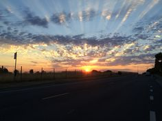 A beautiful morning sunrise after my son's wedding this past July. (taken with my iPhone in my moving car)  LOL