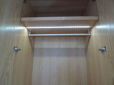 Bespoke wardrobe in oak showing LED lighting on motion sensor