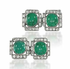 A PAIR OF ART DECO EMERALD AND DIAMOND CUFFLINKS. Each shaped rectangular panel with central emerald cabochon to a circular and baguette-cut diamond surround, circa 1930