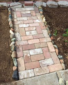 Brick path with stone border.