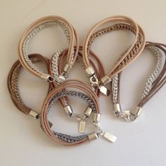 This is my favorite bracelet. It is made of leather and you Can wear to Many colors Clothes.