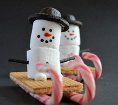 A cute and festive snack out of candy canes, oreos, marshmallows, and gram crackers.