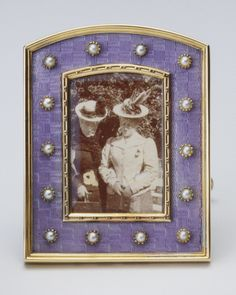Fabergé frame in gold, silver-gilt, lavender guilloché enamel, half pearls,and mother-of-pearl, with a photograph of Princess Maud of Wales and Princess Marie of Greece. Workmaster Viktor Aarne, c. 1897. Probably acquired by Queen Alexandra, date unknown.