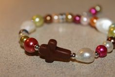 Pearls with a cross bracelet by PearlsBoxForever on Etsy, $9.99