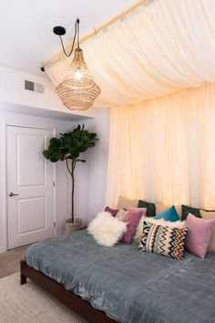 December 2, 2017 called, and it wants to tell you that as of now, traditional headboards are over! Inspired by one of the most popular Pinterest ideas, this gauzy, fairy light-adorned DIY canopy brings an element of dreaminess and elegant drama to a bedro