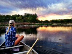 Beautiful scene in the sunset on a boat, fishing in a lake with a beautiful country girl
