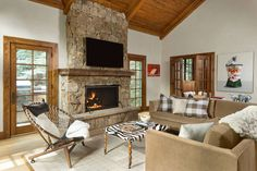 Magnificent mountain style home boasts rustic details in Vail, Colorado #livingroom #fireplace
