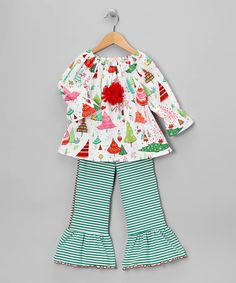 Stripes, flowers and flair—there's no limit to the mixing and matching possibilities of this super-sweet swing set. With an elastic waist and ruffled hem on the pants plus rich hues and a fluffy rosette on the top, this ensemble can liven up any day. Includes top and pants100% cottonMachine wash; tumble dry