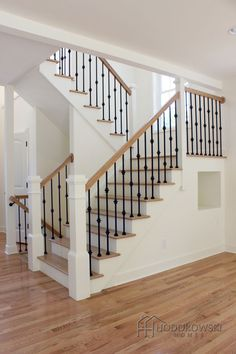 Charming Light Wood Floor, Treads And Rail, White Risers, Iron Spindles, White Newel  Posts.