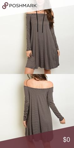 Cold shoulder dress Hip and stylish cold shoulder dress.  High quality material that is soft and flowy. What a great addition to your fall wardrobe! Dresses Mini