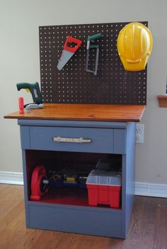 This cool tool bench used to be a thrift store nightstand.  Just paint it and then add a piece of wood for the top and some pegboard!