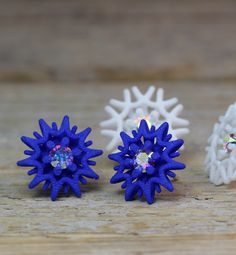 Blue Star Studs with sparkling Crystals. The stud earrings are made of 3d printed Nylon, Sterling silver and synthetic glass crystals