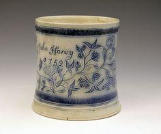 "Antique Pottery Mugs   Scratch-Blue decorated saltglaze tankard dated 1752 named ""J Harvey""."