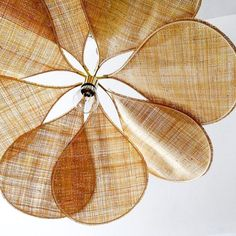 "Pretty 8 petal suspension light ""Pale rafia"" in natural fibre - tightly meshed raffia - with a structure of rattan and brass. By French designer Mylène Scotto and owner of Georges Store Diy Suspension, Interior Styling, Interior Decorating, Fast Furniture, Bungalow Interiors, Light Study, Nature Decor, Home Textile, Ideal Home"