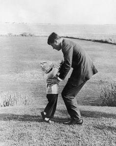 President-elect John F. Kennedy picking up Caroline on the grounds of their home in Hyannis Port, Massachusetts, the day after he won the presidential election.