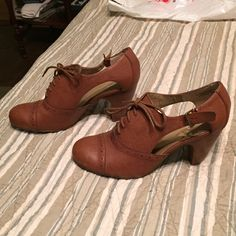 Brown vintage booties Tan cut out booties from crown vintage. Lace up. Perfect condition Crown Vintage Shoes Ankle Boots & Booties