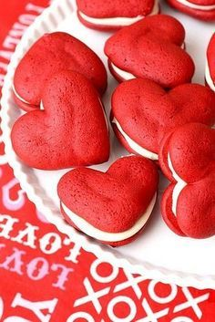 Tutorial for these perfect-for-Valentine's-Day red velvet cake and cream cheese icing filled whoopie pies. Such a cute idea for February birthday parties, too.
