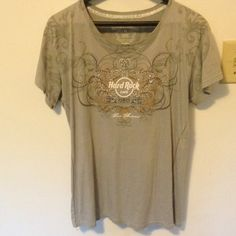 Hard Rock Cafe Tee✨ Hard Rock Cafe -Got from San Antonio . never worn. Gray and different designs and sequins all over . Can fit a LARGE AND XL. On the Back it Says 'Hard Rock Couture' . It's so cute! ✨ Tops