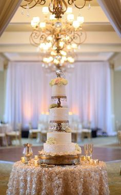 Featured Photographer: Aaron Lockwood Photography, Via Northside Florist; Glamorous sky high white wedding cake with elegant gold frame