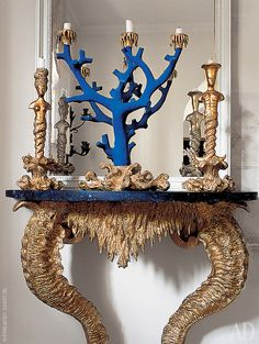 Detail of the interior.  Console, candlesticks in the form of sirens and coral made artist Oriel Harwood.