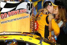 At-track photos: Saturday, Kansas:   Sunday, May 8, 2016  -   A big kiss for the winner! Samantha smooches husband Kyle Busch after his Kansas victory.  -   Photo Credit: Photo by Brian Lawdermilk/Getty Images