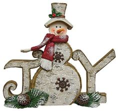 Joy Snowman Sign has a rustic wood look, accented with glitter, resin and rusty snowflakes. The sign is 6½inches high by 7¼inches wide and 1½inches deep.
