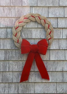 New England meets Chesapeake Bay for the perfect Coastal Christmas. This Natural Rope Wreath can be adorned with Red, Green or Navy Ribbon to match your decor. Handmade in Marblehead, MA.This Pin was discovered by DİL Rope Crafts, Wreath Crafts, Diy Wreath, Christmas Projects, Diy And Crafts, Christmas Crafts, Christmas Decorations, Christmas Ornaments, Wreath Bows