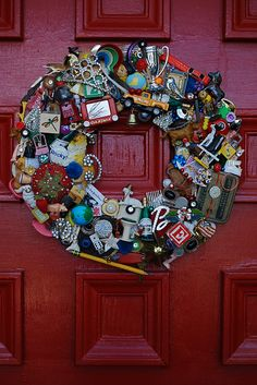 DIY:  Bits & Pieces Wreath -  great way to use those favorite old toys!  This would make an awesome gift to the person whose toys were used in the wreath. Inspiration.