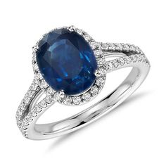 A classic but stylish choice, this elegant sapphire gemstone ring is surrounded by a halo of pavé-set diamonds and showcases a split shank adorned with round diamonds framed in 18k white gold.