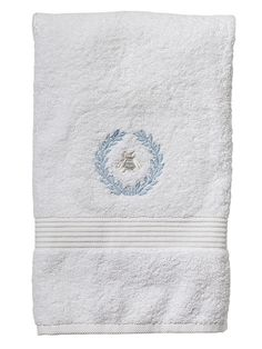 Embroidered white bath towel with a blue bee wreath from Jacaranda Living