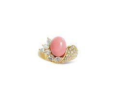 Set with an oval-shaped pink conch pearl, enhanced by pear and marquise-cut diamonds, mounted in 18k white gold, ring size 6, signed M.